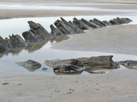 Wreckage from the Spanish Armada ships visible on the beach at Streedagh