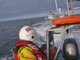 Portaferry RNLI's Atlantic 85 class lifeboat Bluepeter V tows the stricken yacht to Strangford