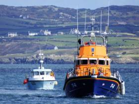 Holyhead's all-weather lifeboat Christopher Pearce returning to shore with the stricken Irish vessel