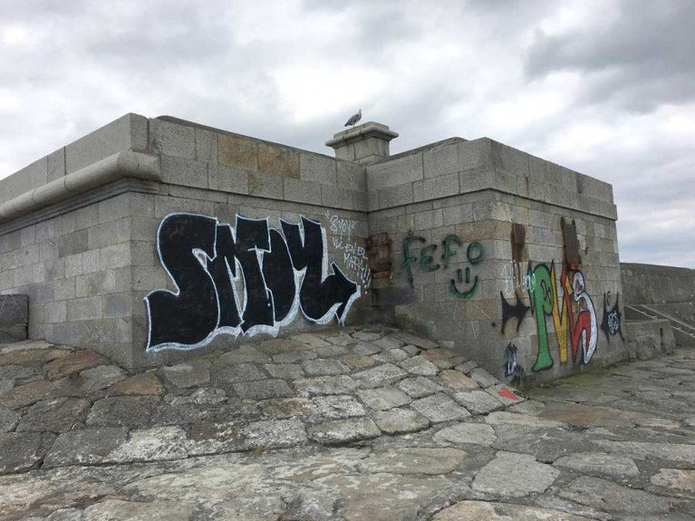 Vacant buildings are blighted by graffitii on Dun Laoghaire's West Pier. The council says graffiti poses a significant problem throughout the Dun Laoghaire area