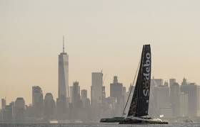 Coville's giant multihull crossed the finish line off Sandy Hook at 09:02:02 BST, having travelled a total of 4,656 nautical miles