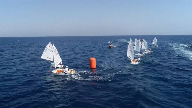 Racers round a mark on day 7 of the Optimist World Championships in Cyprus