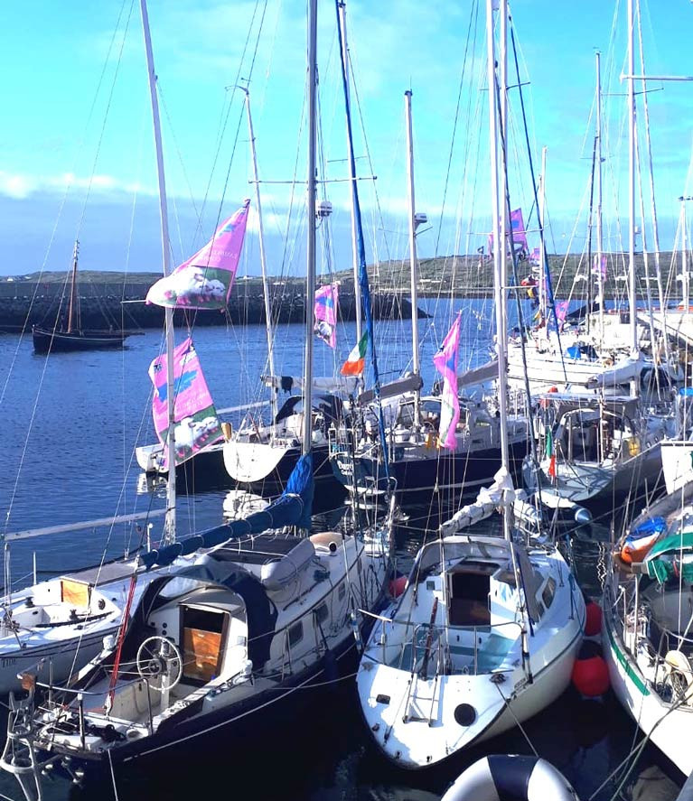 "Escape to the islands…..late evening sunshine in Kilronan in the Aran Islands yesterday (Friday) evening as Galway Bay SC cruisers on their way to Roundstone and Inishbofin meet up with the Quinlan-Owens family in their Transatlantic-voyaging Danu. The lilac-pink banners indicate participation in the GBSC ""Lambs Weekend""."