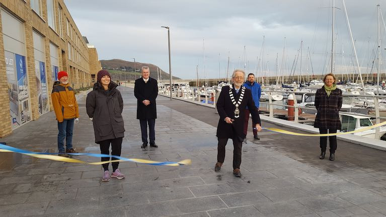 Cllr Derek Mitchell cuts the ribbon on the new coastal park and boardwalk overlooking Greystones Marina in County Wicklow. Front row left to right: Pamela Lee, Derek Mitchell, Breege Kilkenny (Director of Planning WCC),  Back Row. Norman Lee, Frank Curran (Chief Executive WCC), Merlin Ovington (WCC)