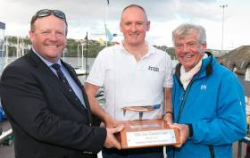 Phil Plumtree, skipper of Swuzzlebubble (centre) receives the overall trophy from Thomas Roche, Commodore of Kinsale YC (left) and Philippe Pilate, President of the Half Ton Class at the prize-giving for the Euro Car Parks Half Ton Classics Cup 2017 at Kinsale Yacht Club, Ireland
