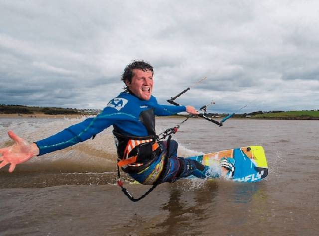 Niall Roche rips through the surf by kite