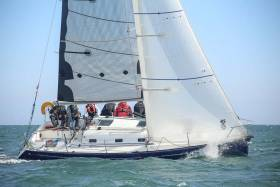 A well set–up Beneteau 31.7 racing on Dublin Bay. There are good gains to be made in adjusting the rig regularly – read how how to set up the mast and sails for best performance upwind in different wind conditions below
