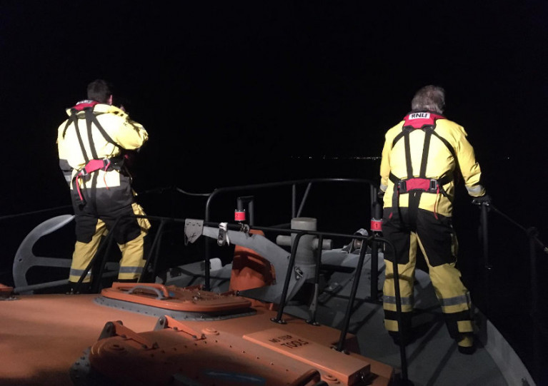 Arklow RNLI volunteer crew look for signs of distress under searchlights on Saturday night