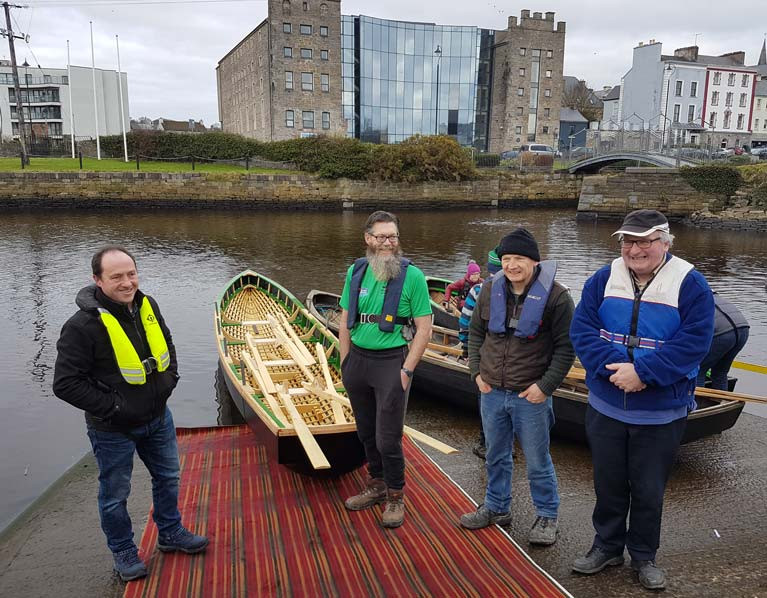 The replica currach was built by James Madigan (left) with help from club members