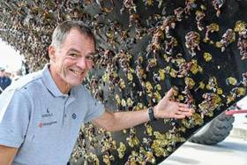 Bitter sweet moment: Tapio Lehtinen shows the strong barnacle growth on the bottom of his solo yacht Asteria, and finds they are a delicacy in France selling for 80 Euros per Kilo