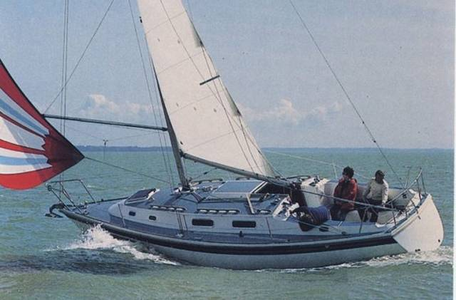 The comfortable yet efficient cruising capacity of the Westerly Fulmar is indicated by the ease with which she can carry a spinnaker while reaching without being heavy on the helm
