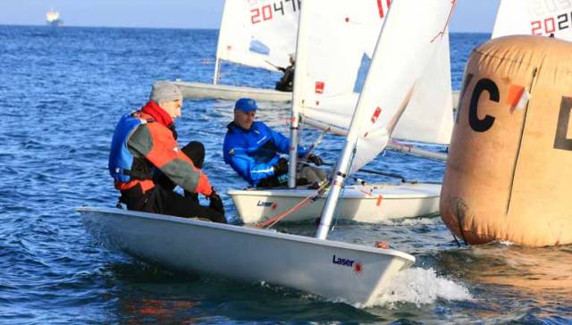 Laser Radials reach a weather mark at the DMYC Frostbites in Dun Laoghaire Harbour