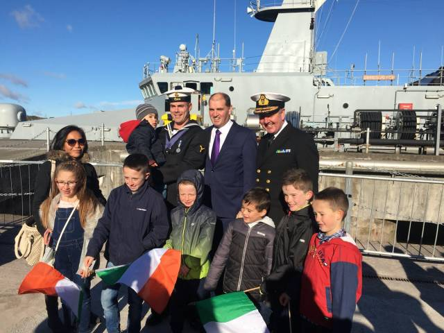 "A crew member of LÉ James Joyce along with Chief of Staff of the Defence Forces, Vice-Admiral Mark Mellett (on right) and Minister with Responsibility for Defence, Paul Kehoe who commented on the arrival: ""It was a privilege to greet ship captain Lt commander Martin Brett and the rest of the crew who will now enjoy a well-earned break with their families""."
