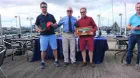 Ross Nolan (left) and Gordon Patterson (right) receive their Championship prize from Howth Yacht Club Commodore Ian Byrne