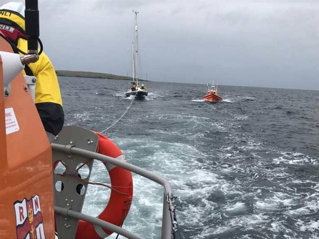The yacht under tow by Clifden RNLI
