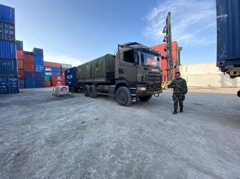 Óglaigh na hÉireann personnel collecting medical supplies for delivery to Irish Hospitals, supporting the HSE in the fight against COVID-19. AFLOAT adds the Irish Army truck is seen with a shipping container trailer at a port's lo-lo container terminal.