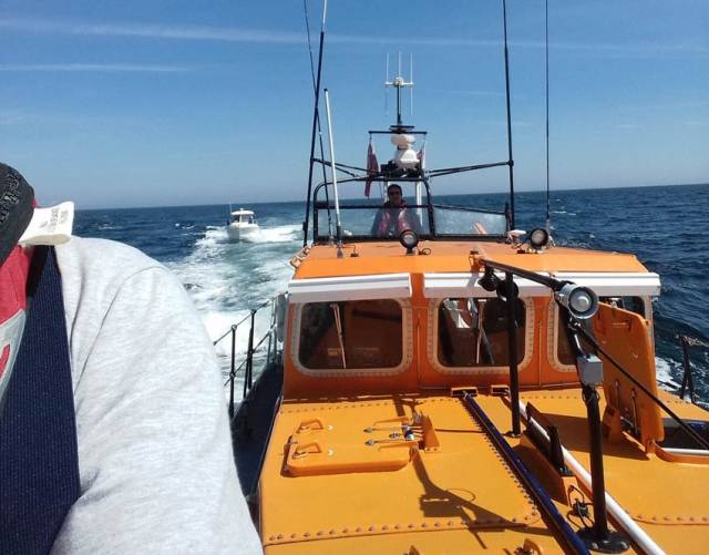 Ramsey RNLI with the casualty vessel safely in tow