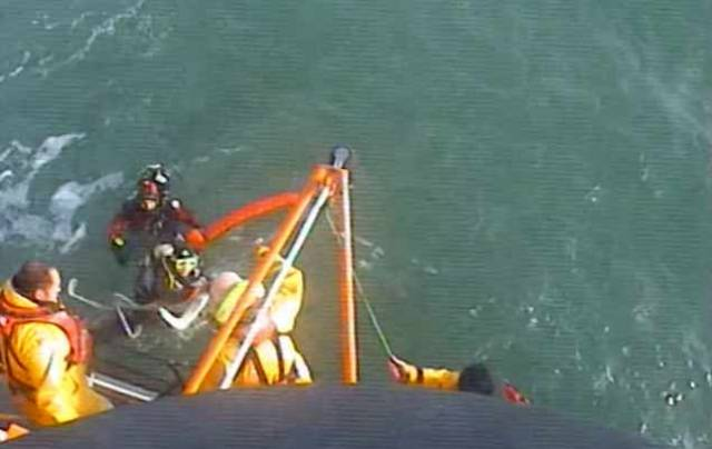 The RNLI All-Weather lifeboat located the casualties south-east of the Muglins Rock fifteen minutes after launching