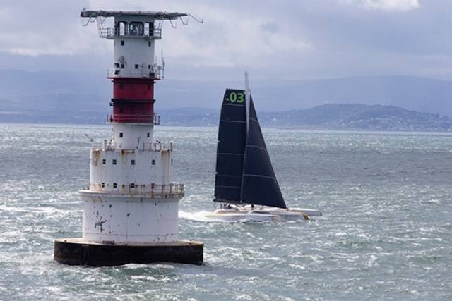 Round Ireland Record bid – MOD 70 Phaedo3 takes off at the Kish Lighthouse on Dublin Bay this afternoon