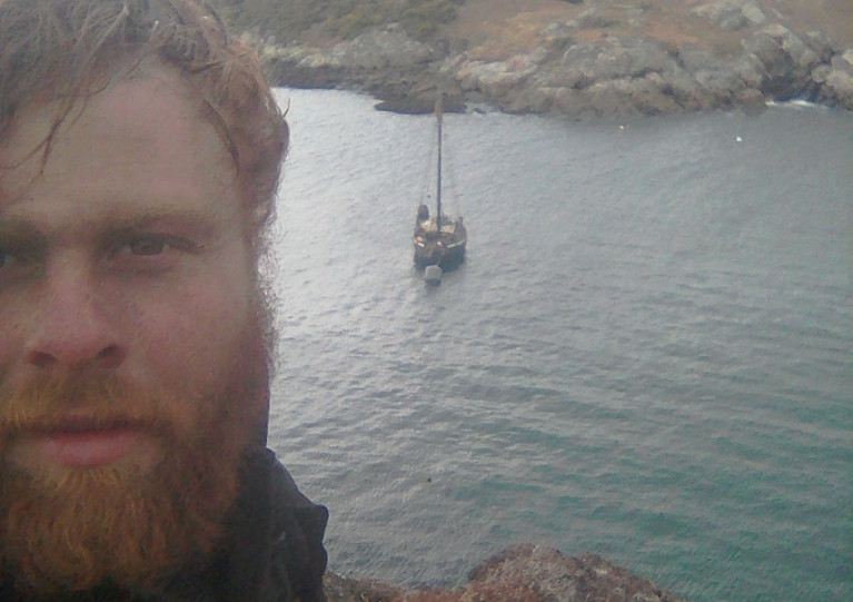 Solo adventurer Darragh Carroll and his boat Rán in northern Scotland in March