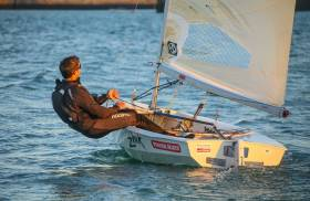 Solo sailor – GP14 world champion Shane MacCarthy out and about in Dun Laoghaire in his Solo dinghy. The design features inward sloping decks, making it more comfortable to sit–out