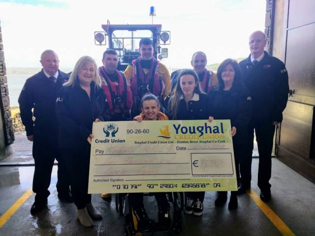 Leanne and Aisling Hehir presenting a cheque to Youghal RNLI volunteers on Saturday 16 February