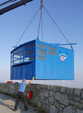 Back on station – DBSC's new and improved Starters Hut is lowered back into position on the West Pier