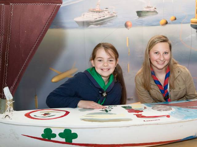 Méabh Ní Ghionnáin and Kaitlyn Dow with the unmanned sailboat that brought them together