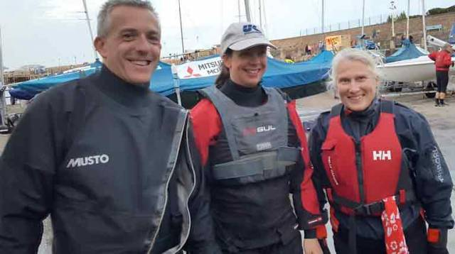 Flying Fifteen sailor Ian Mathews (left) with Ciara and Rosemary of the NYC's Adult Sail Training Group