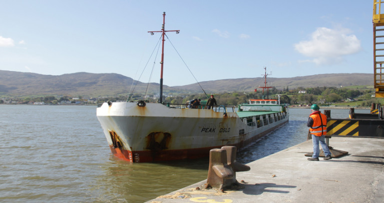 Carlingford Lough: Warrenpoint Port's AGM (Annual Report - 2019) was held virtually for the first time due to restrictions imposed by the impact of Covid-19. Above AFLOAT adds is the low-air draft general drycargo short-sea trader Peak Oslo (formerly Union Sun) on the Lough which derives its name from the Old Norse Kerlingfjǫrðr, meaning 'narrow sea-inlet of the hag'. The ship in this foreshortened view is deceptive given its 87.66m length, a beam of 11.05m and a draft of 2.7m. The 1985 built / 1,543 grt ship is from the an original series built for Union Transport Group based in Kent, UK, that included Union Moon which along with a ferry collided into eachother in Belfast Lough as Afloat reported in 2012. Later that year the MAIB deemed both vessels at fault for the incident.