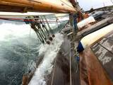 Editorial desk with a difference……..on board the 64ft gaff cutter Annabel-J, powering along off the West Coast of Ireland. Annabel-J is owned by long distance voyager Andrew Wilkes and his wife Maire Breathnach of Dungarvan, who is currently Honorary Editor of the Irish Cruising Club Annual