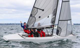 Simon Childs, Mike McIntyre (waving) and Caroline McIntyre retained their title as RS Elite National Champions