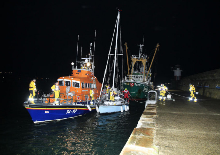 Arklow RNLI brings the distressed yacht alongside at Wicklow Harbour