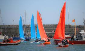 An umpire (in RIB, left) observes a start line at the Elmo Cup Team Racing Competition in Dun Laoghaire