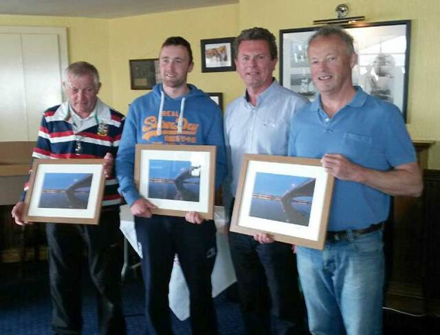 Derek Joyce (right) of 187 Zuleika, claiming his Leinster title pictured with his crew James Sinnott and Cillian Joyce and Michael Conway of Wexford Harbour Boat and Tennis Club