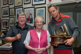 Cian McCarthy (right) winner of the Bertoletti Trophy, receives his prize from Patricia Bertoletti and Kinsale Yacht Club Commodore David O'Sullivan