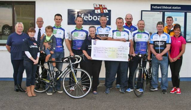 Ring of Kerry cyclists with their cheque for Fethard RNLI