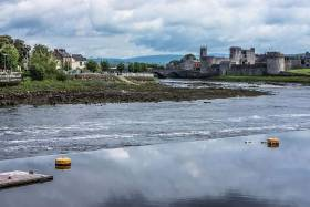 River Shannon flowing past King John's Castle in Limerick, where Jim Kennedy and company will complete their recreated 'paddle for peace'