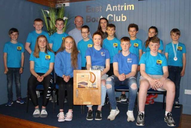 Proud Commodore Steven Kirby and club coach Debbie Hannah (back row) with the victorious East Antrim BC junior and youth squad with the prestigious 'Top Club' trophy won at the recent RYA-NI Youth Championship