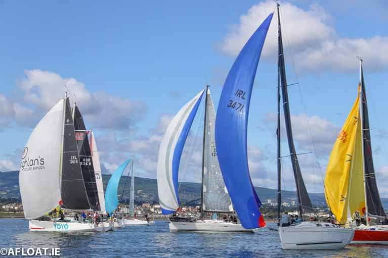Class Two winner Black Velvet (blue kite) on port gybe shortly after the start of the second race of the ISORA Viking Marine Coastal Series