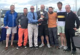 Jibe presented with Eastern Championship trophy by Ian Byrne, Commodore Howth Yacht Club  (from left to right : Brian McDowell J/24 Association President, Fergus Kelliher, Ian Byrne Commodore HYC, Brendan Culloty, Michael McCormack, Timothy Kelliher, Mark Mulrooney)