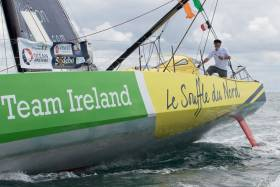 Enda O'Coineen on the deck of his IMOCA 60