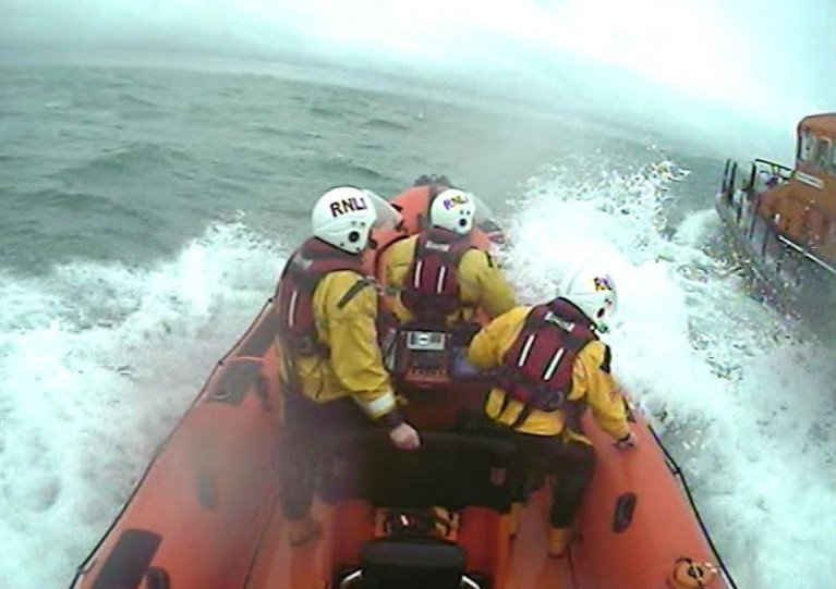 Skerries volunteers in their inshore lifeboat alongside Howth RNLI