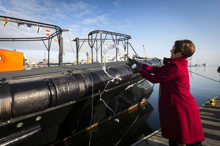 Poolbeg Vice Commodore Eileen Murray carried out the traditional smashing of a champagne bottle on the bow of the Tolka