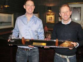 Ronan Kenneally (left) is presented with 'The Yard-of-Ale' Trophy by Charles Dwyer on Winning the Monkstown Bay Sailing Club's Laser Winter League for the second-year in succession