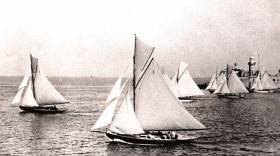 There are two diametrically opposed ways of looking at this photo of the Dublin Bay 25s starting a race a very long time ago through the entrance of Dun Laoghaire Harbour. You either loathe it as being a way of beginning a race which puts too much emphasis on luck. Or you can love it as being a celebration of wayward sailing skills which rely on local knowledge and sheer cunning.