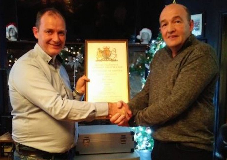 Deputy launching authority Brendan O'Driscoll (left) presents John Innes with a certificate of service