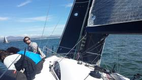 Crew man Ewan O'Keefe runs the rule over mainsail trim on board Jump Juice at Abersoch keelboat week