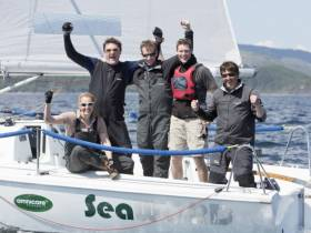 Dara O'Malley (second left) and his crew in on their Hunter 707 Seaword after yesterday's overall victory in the Silvers Marine Scottish Series at Tarbert
