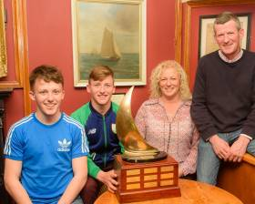 The Durcan family: twins Harry and Johnny, with mother Yvonne and father Tom andThe Pyewacket Trophy at RCYC on Friday night